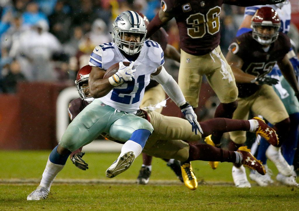 Dallas Cowboys running back Ezekiel Elliott (21) gets away from a tackle by Washington Redskins cornerback Kendall Fuller (29) during the third quarter at FedEx Field on Sunday, Oct. 29, 2017, in Landover, Md. The Cowboys won 33-19. (Jae S. Lee/The Dallas Morning News)