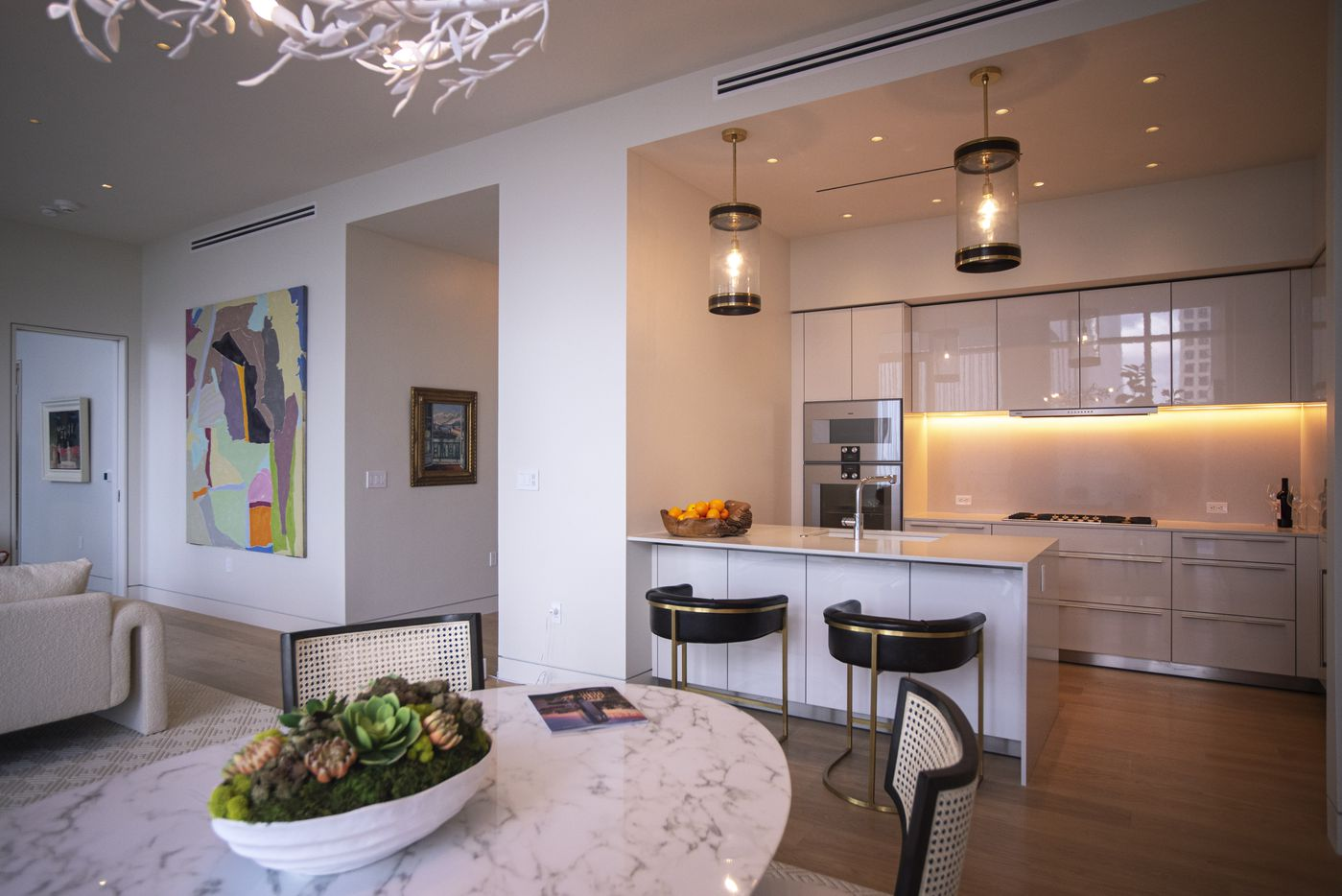 Dinning and kitchen space inside a condo at the Hall Arts Residences.