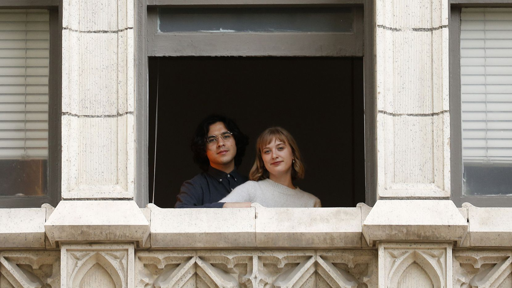 """Benjy and Marie Joung pose for a portrait at their apartment in downtown Dallas on Tuesday.  Marie says, """"recognizing the social responsibility I have as a young, healthy person with the ability to work from home, I have been isolating much more seriously this week."""""""