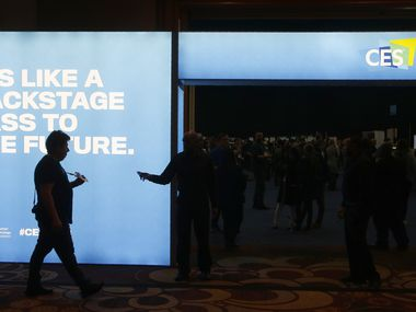 A patron has identification checked at the entrance to the CES Unveiled media preview event before the kickoff of CES.