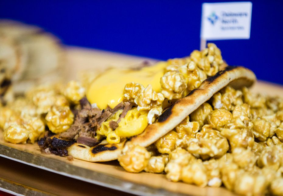 Here's a new Rangers item: the Popcornopolis Pita, a smoked brisket sandwich topped with mac 'n cheese and caramel popcorn. It's sweet and salty. And a little strange.