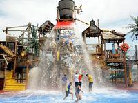 Kids run and play at Hooks Lagoon at Hurricane Harbor in Arlington.