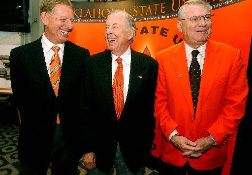 From left: Mike Holder of Oklahoma State University, T. Boone Pickens and then-OSU President David Schmidly posed for photographs after a news conference announcing Pickens' $165 million donation to the university in 2006.