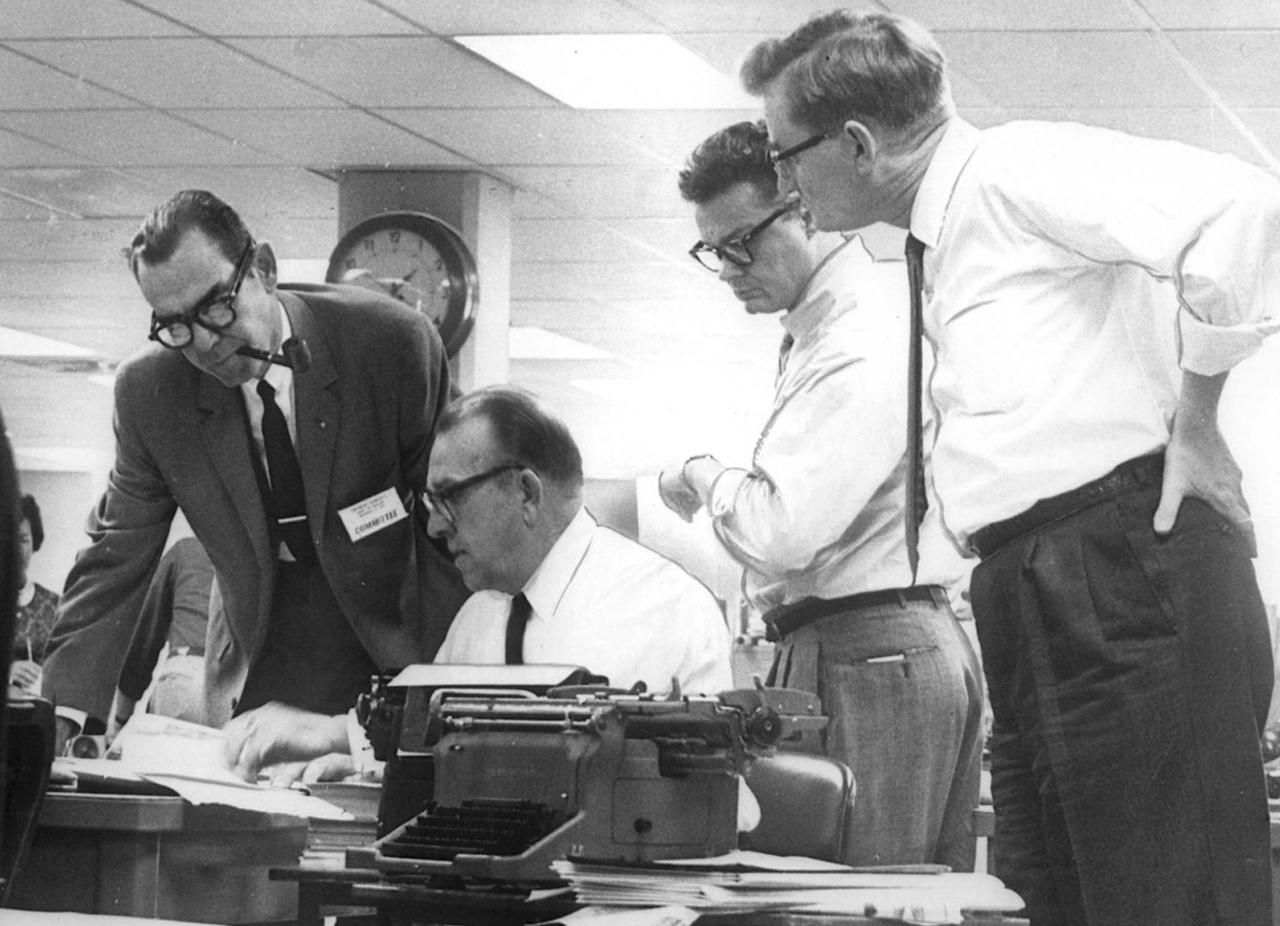 Felix McKnight (seated) joined co-publisher James Chambers Jr. (left), Blackie Sherrod and A.C. Greene as the staff of the Dallas Times Herald worked on coverage of the JFK assassination on Nov. 22, 1963.