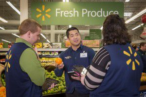 """Wal-Mart training manager Steven Yu leads a team of 14 trainers at a store in Carrollton. The store is the first training """"academy"""" for frontline managers. Wal-Mart expects to open more than 200 of these academies by the end of 2017. The training centers will be inside or adjacent to stores."""