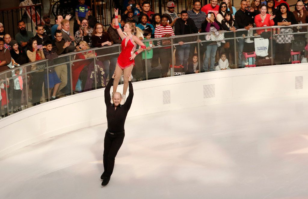 The 2012 U.S. National Champions Caydee Denney and John Coughlin perform during the Macy's Grand Tree Lighting Celebration at Galleria Dallas on Black Friday, November 25, 2016 in Dallas, Texas. (David Woo/The Dallas Morning News)