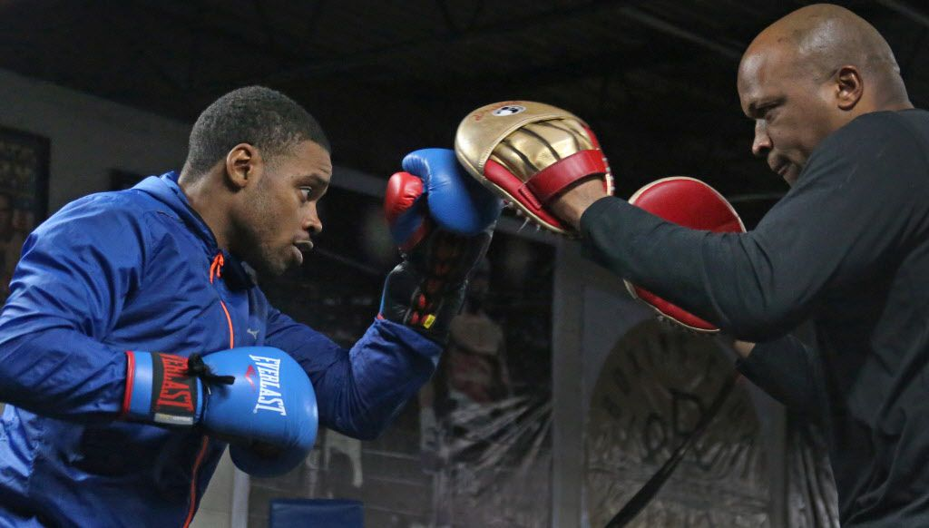 Boxer Errol Spence Jr. works out with trainer Derrick James at R&R Boxing Club in Dallas on Friday, December 22, 2017. (Louis DeLuca/The Dallas Morning News)