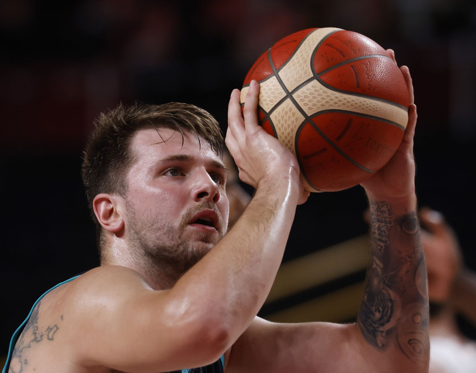 Slovenia's Luka Doncic (77) shoots a free throw in a game against France's during the first half of a men's basketball semifinal at the postponed 2020 Tokyo Olympics at Saitama Super Arena, on Thursday, August 5, 2021, in Saitama, Japan. (Vernon Bryant/The Dallas Morning News)