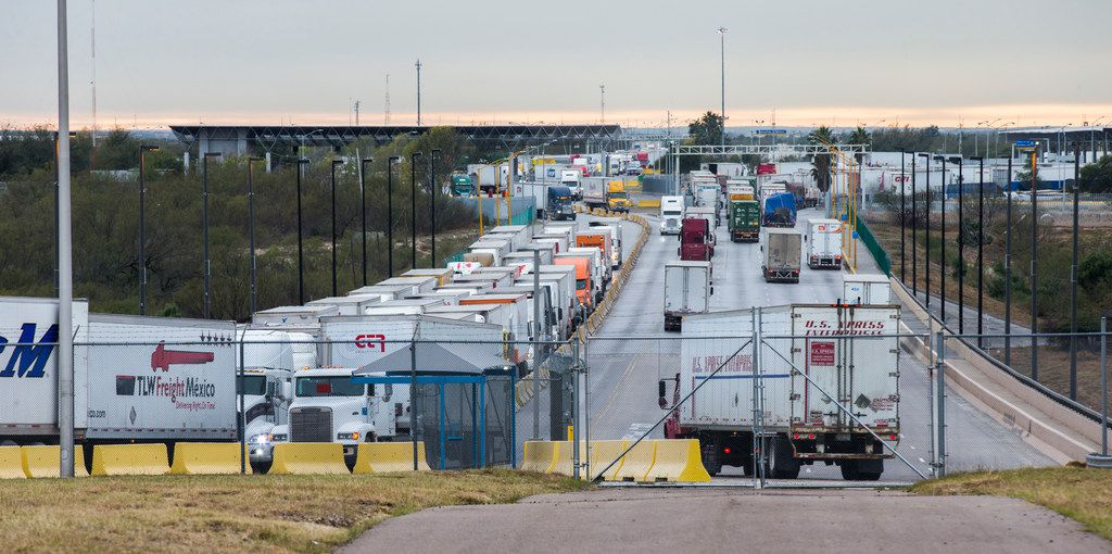 Trucks pass through the World Trade Bridge from Mexico to the U.S. (left) and from the U.S. into Mexico on Jan. 18, 2018, in Laredo.