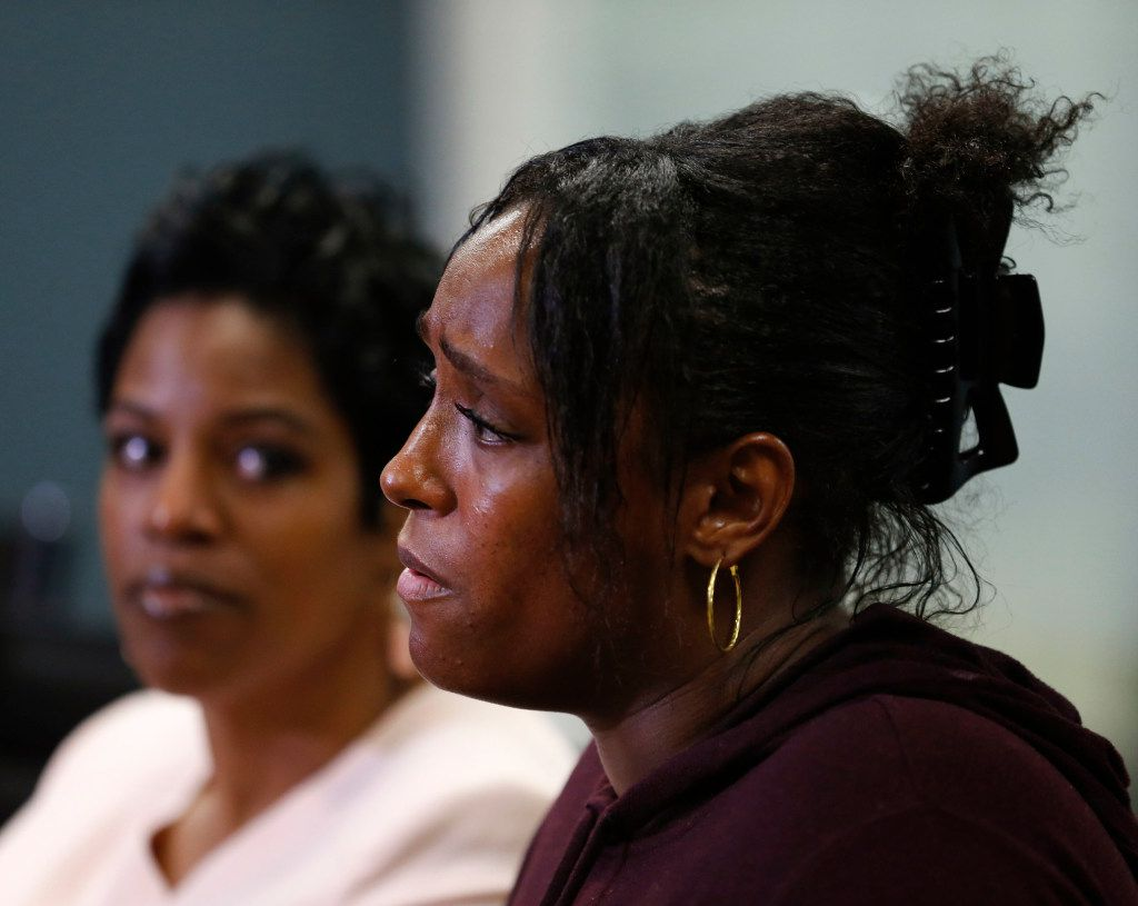 Latasha Nelson speaks during a news conference  alongside her two sons, Trayvon, 14, and Broderick, 16.