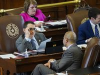 Rep. Briscoe Cain, R-Deer Park, (with glasses) talks with Rep. Cody Harris, R-Hillsboro while democrats speak against SB-7 in the House Chamber at the Texas Capitol during the 87th Texas legislature on Friday, May 7, 2021, in Austin. (Smiley N. Pool/The Dallas Morning News)