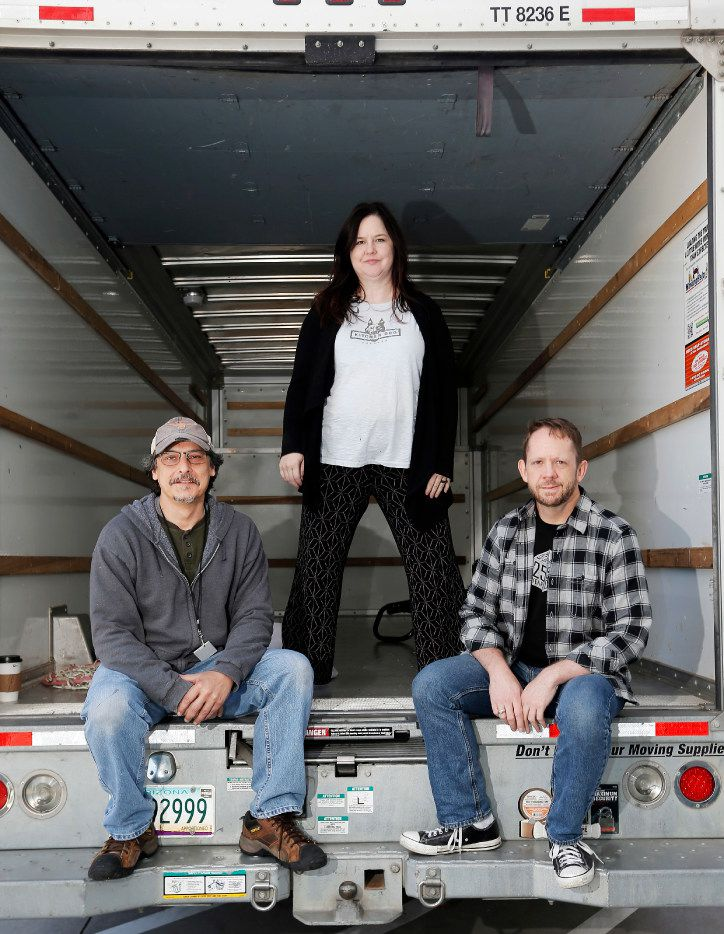 (L to R) Kitchen Dog Theater's Co-Artistic Directors Chris Carlos and Tina Parker and Managing Director Tim Johnson pose for a photo in the back of a moving truck at the Wyly Theater in Dallas, Sunday, May 30, 2017. Kitchen Dog Theater has had to move five times in two years, most recently from Trinity River Arts Center, when it was closed down by a fire marshal in the midst of a performance, to the Wyly Theatre to do a shorter than planned run of their new show, Trevor. (Brandon Wade/Special Contributor)