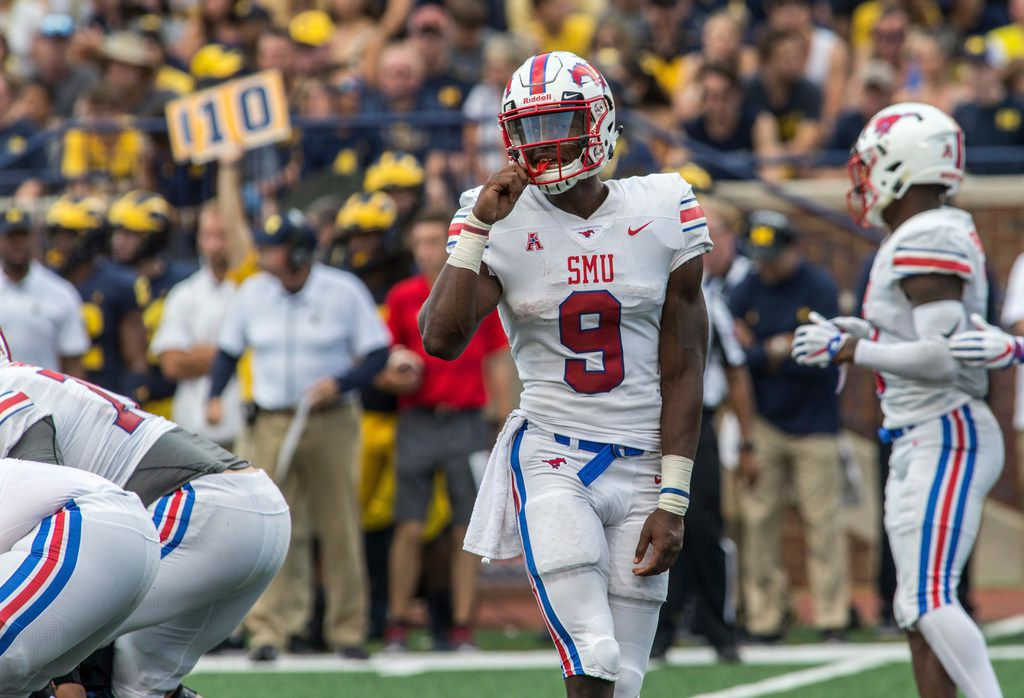 SMU quarterback William Brown (9) looks to his sideline between downs in the third quarter of an NCAA college football game against Michigan in Ann Arbor, Mich., Saturday, Sept. 15, 2018. Michigan won 45-20. (AP Photo/Tony Ding)