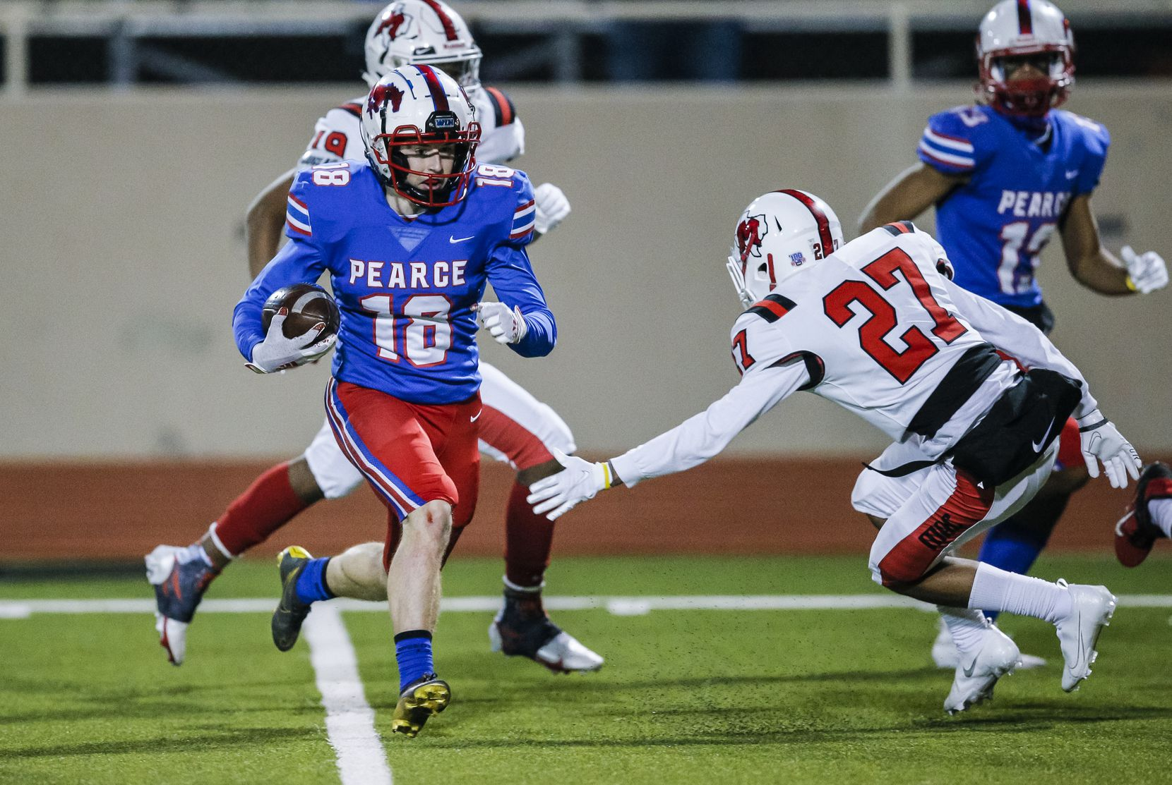 JJ Pearce junior running back Adam Velin (18) avoids a tackle by Irving MacArthur junior Perry Rakestraw (27) during the first half of a high school playoff football game at Eagle-Mustang Stadium in Richardson, Thursday, December 3, 2020. (Brandon Wade/Special Contributor)