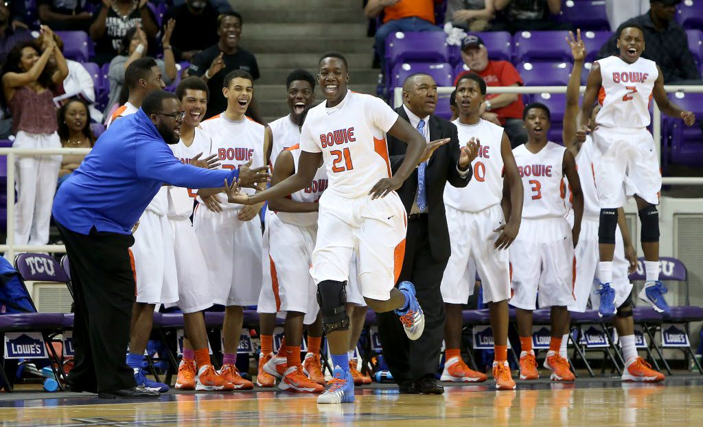 The Arlington Bowie bench reacts to a three-pointer made by Volunteers forward Kevin Hervey (21) in the second half of the Class 5A Region I semifinal boys basketball game at Daniel-Meyer Coliseum in Fort Worth, Texas on Friday, February 28, 2014. (Brad Loper/The Dallas Morning News)