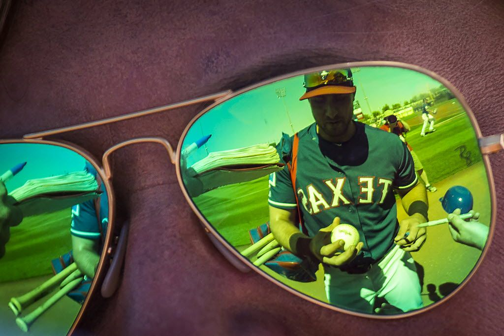 Texas Rangers third baseman Joey Gallo is reflected in a fan's sunglasses as he signs autographs before a spring training game against the Los Angeles Dodgers at Surprise Stadium on Friday, March 4, 2016, in Surprise, Ariz. (Smiley N. Pool/The Dallas Morning News)
