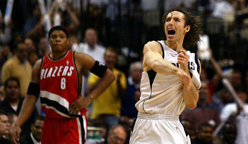 FILE — Dallas Mavericks' Steve Nash celebrates making a three-pointer as Portland's Bonzi Wells watches in the third quarter of Dallas' 107-95 win  at the American Airlines Center Sunday. Nash was recently hired to coach the Brooklyn Nets.