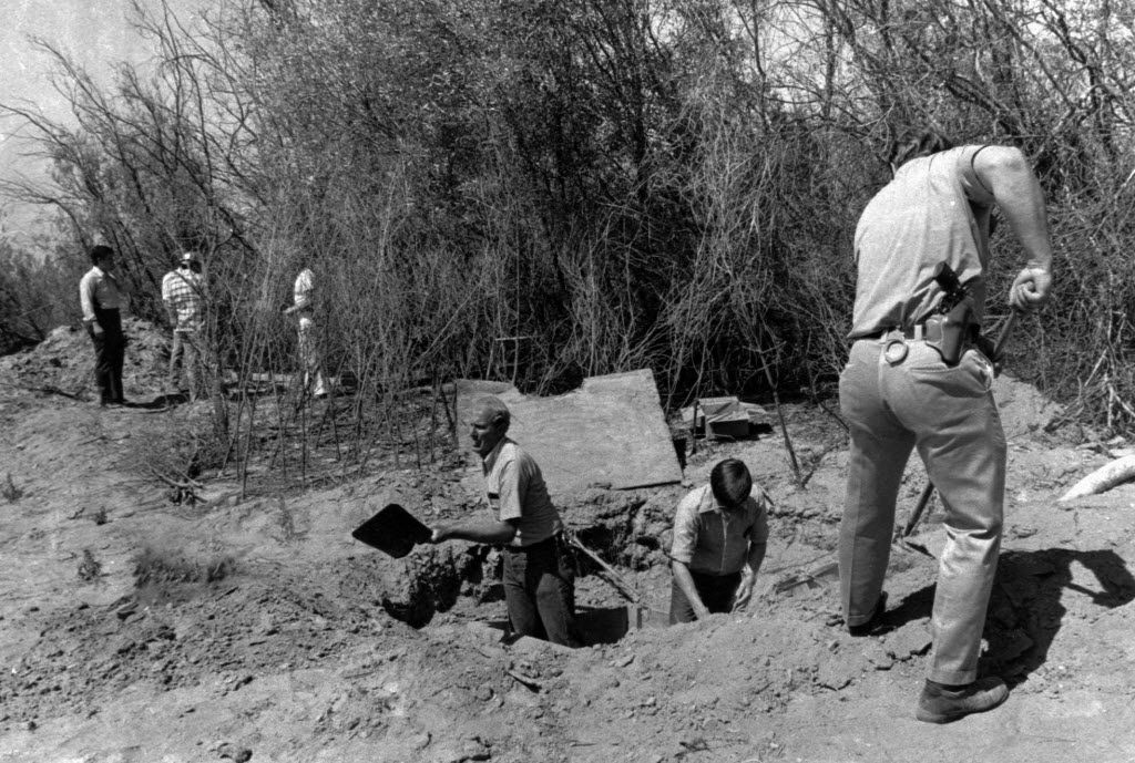 In this July 17, 1976, file photo, members of the Alameda County Crime Lab and FBI are pictured working around the opening to the van where 26 Chowchilla school children and their bus driver were held captive at a rock quarry near Livermore, Calif. Frank Edward Ray Jr., the school bus driver hailed as a hero for helping the students escape, remembered the numbers on their abductors' license plate under hypnosis.