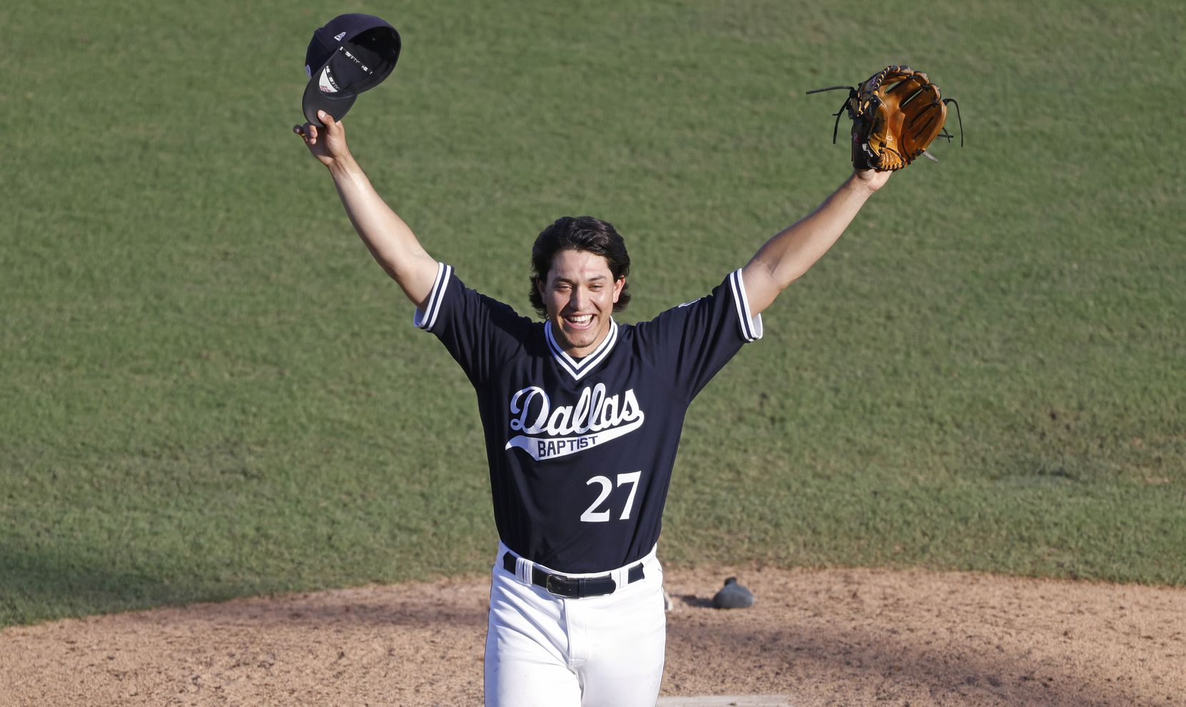 Dallas Baptist pitcher Dominic Hamel (27) celebrates the team's 8-5 win over Oregon St. following the NCAA Division I Baseball Regional Championship game in Fort Worth, Texas on June 7, 2021. (Ron Jenkins/Special Contributor)