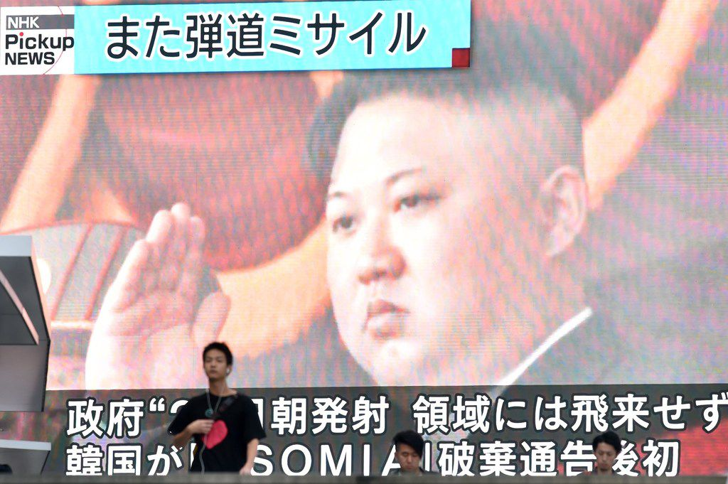 """Footage of North Korea's leader Kim Jong Un is seen on a giant television screen in Tokyo on Aug. 24, 2019, reporting on North Korea's missile launch earlier in the day.  North Korea fired what appeared to be two short-range ballistic missiles  into the sea after vowing to remain the biggest """"threat"""" to the United States and branding Secretary of State Mike Pompeo as """"toxin."""""""