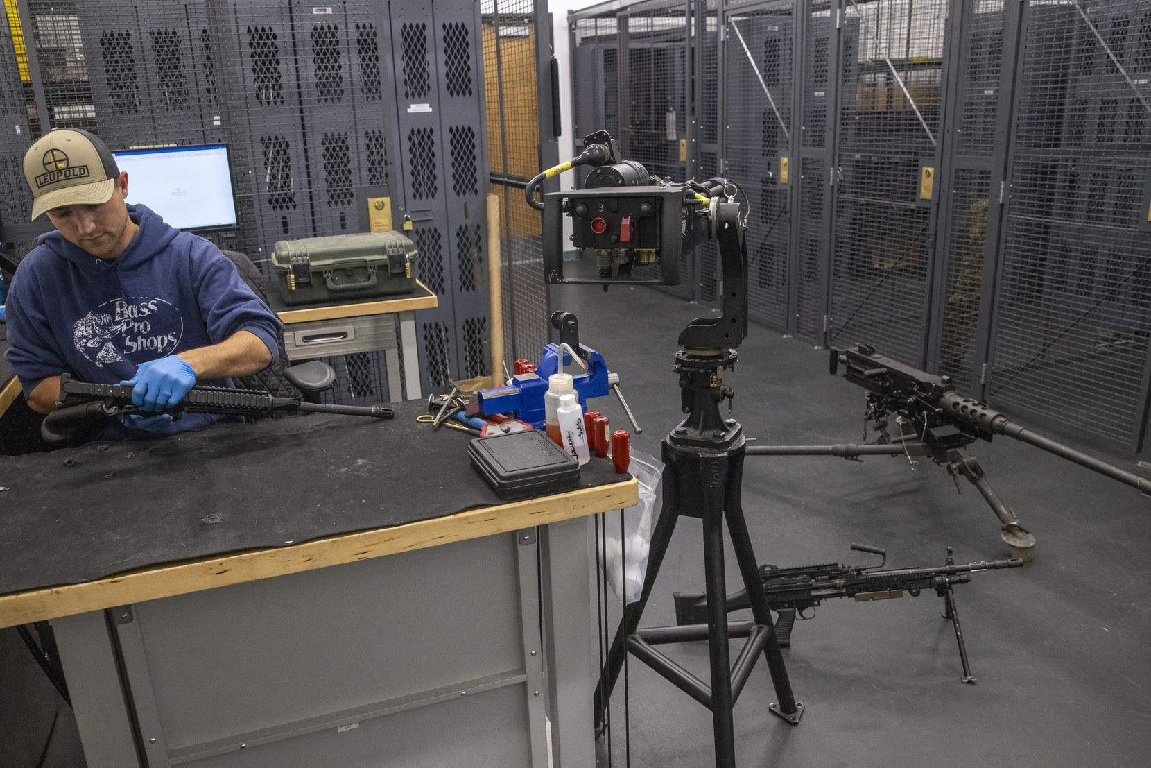 Armory supervisor Jake Evans services weapons at the armory of the True Velocity manufacturing center in Garland.