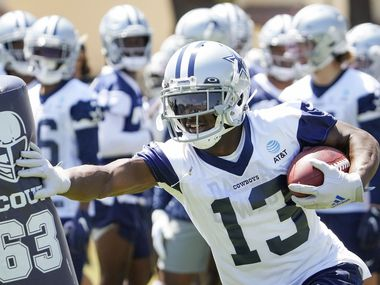 Dallas Cowboys wide receiver Michael Gallup (13) participates in a drill during the first practice of the team's training camp on Thursday, July 22, 2021, in Oxnard, Calif.