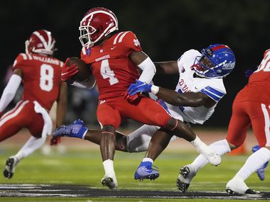Mater Dei running back Raleek Brown (4) is brought down by Duncanville linebacker Jordan Crook (2) during the first half of a high school football game on Friday, Aug. 27, 2021, in Duncanville.