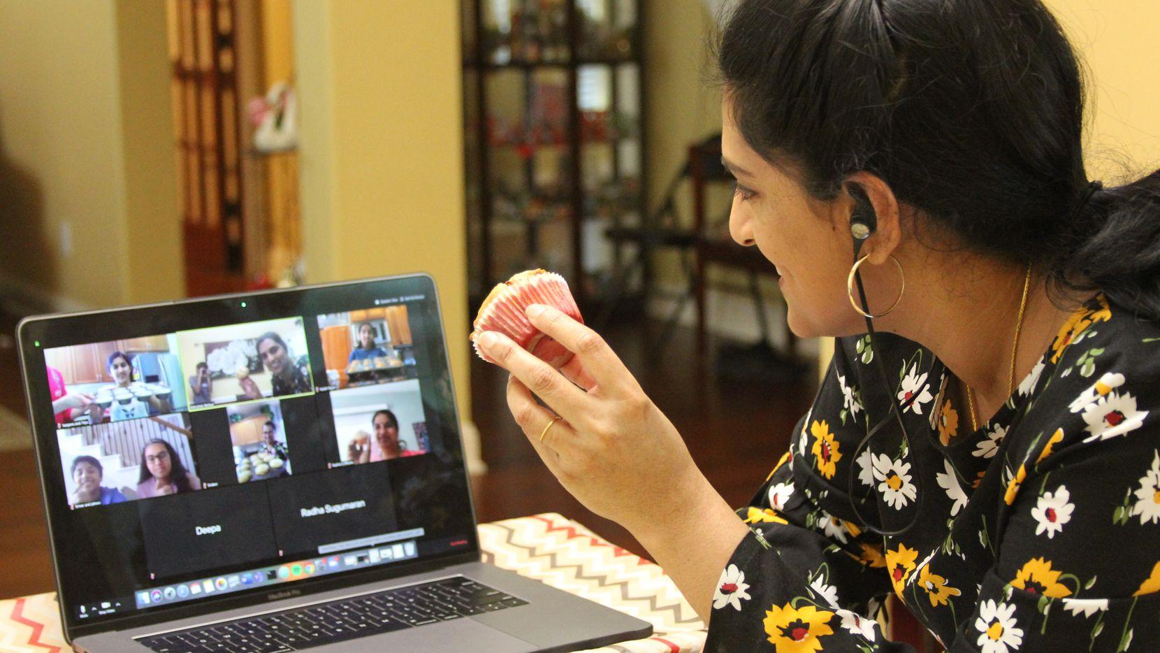 Jayashree Krishnan holds a muffin during an online baking class.