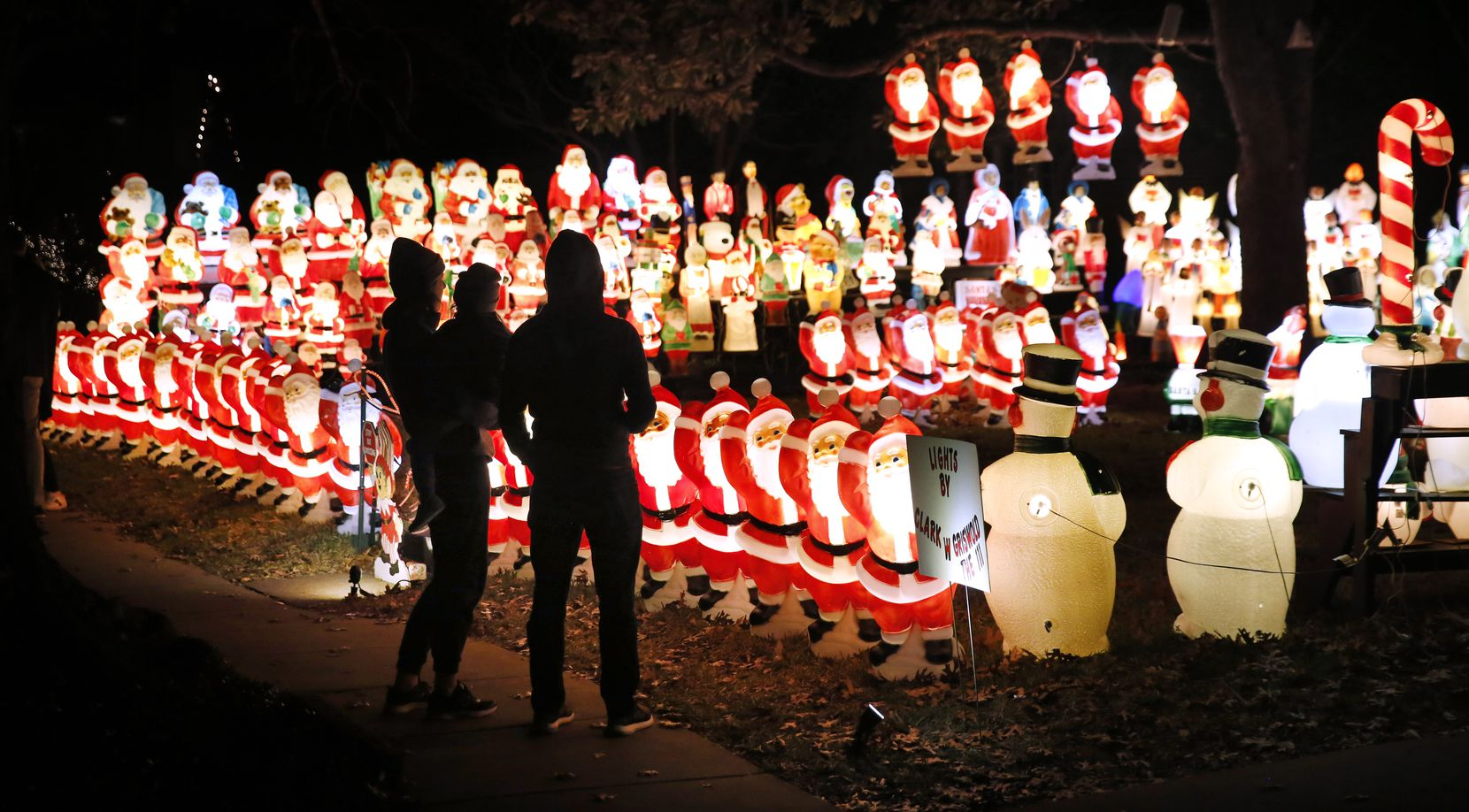 Visitors view the holiday scene in Wayne Smith's University Park yard.