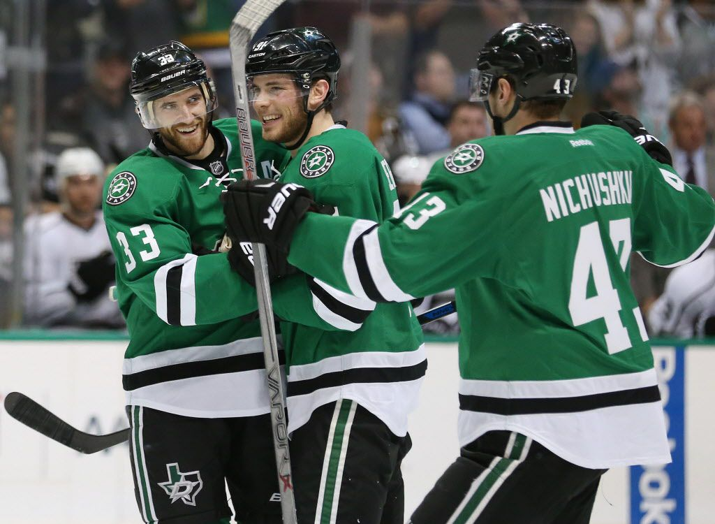 Dallas Stars defenseman Alex Goligoski (33) celebrates with center Tyler Seguin (91) and right wing Valeri Nichushkin (43) after Goligoski scored a goal in the first period during a National Hockey League game between the Los Angeles Kings and the Dallas Stars at the American Airlines Center in Dallas Tuesday March 15, 2016. The Los Angeles Kings led the Dallas Stars 3-1 after the first period. (Andy Jacobsohn/The Dallas Morning News)