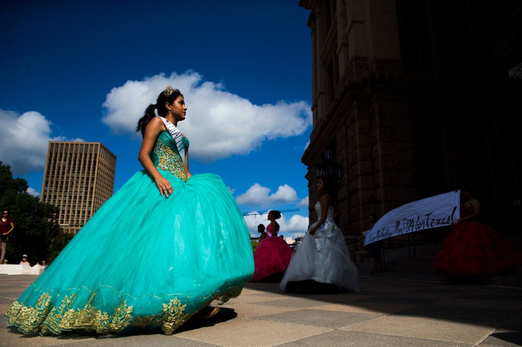 Emelyn Macias performs as she and other teenage girls with Jolt Texas hold symbolic quinceaneras to protest the sanctuary cities ban on Wednesday outside the Texas Capitol in Austin.