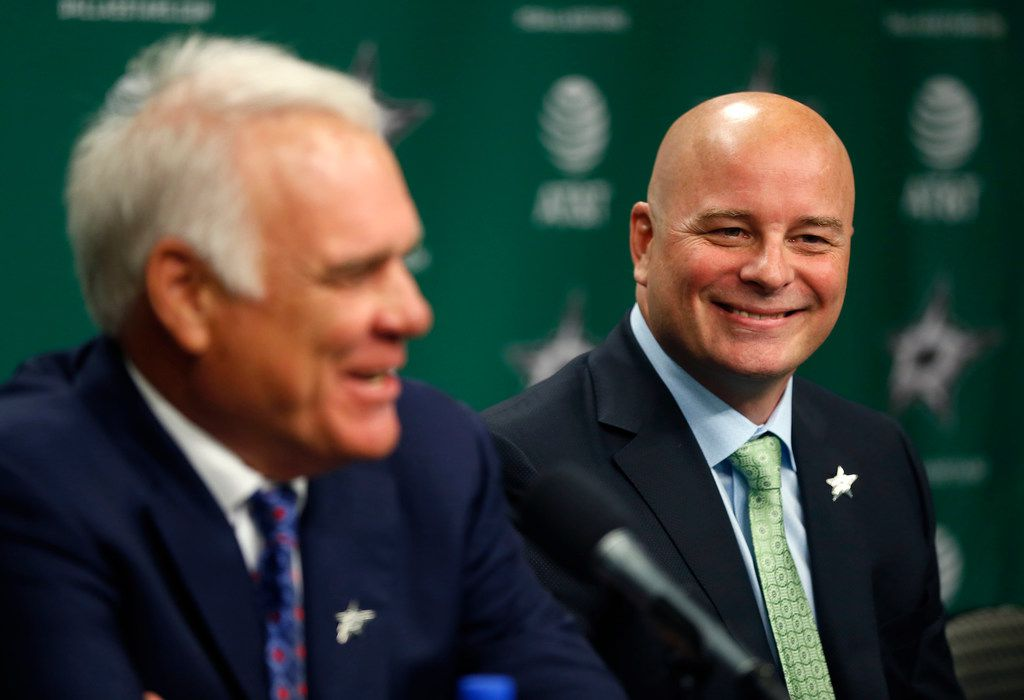 New Dallas Stars head coach Jim Montgomery, right, smiles as Chief Executive Officer Jim Lites talks during a press conference at American Airlines Center in Dallas, Friday, May 4, 2018. (Jae S. Lee/The Dallas Morning News)