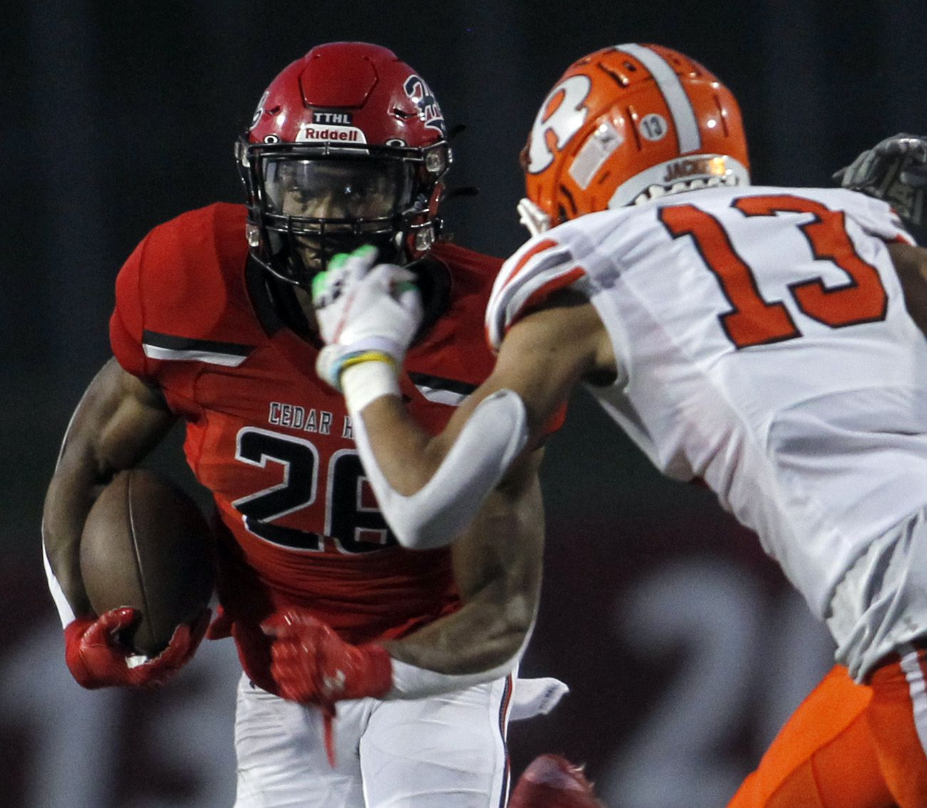 Cedar Hill running back Jaylen Jenkins (26), left, eyes the defense of Rockwall cornerback Cadien Robinson (13) before cutting to the outside enroute to a 55-yard rushing touchdown during first half action. The two teams played their season opening football game at Longhorn Stadium in Cedar Hill on August 27, 2021. (Steve Hamm/ Special Contributor)