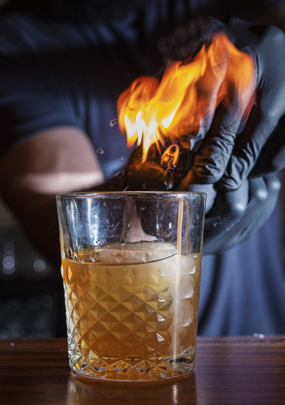 Beyond cocktails and ax throwing, there's also fire. The Lemon Honeysuckle Old Fashioned is made with Buffalo Trace Bourbon, local honey and a flamed lemon at Whiskey Hatchet in Dallas.