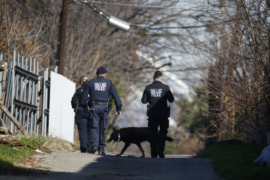 Dallas police work a crime scene in the 400 block of East Ninth Street near Adamson High School on Wednesday, Dec. 11, 2019.