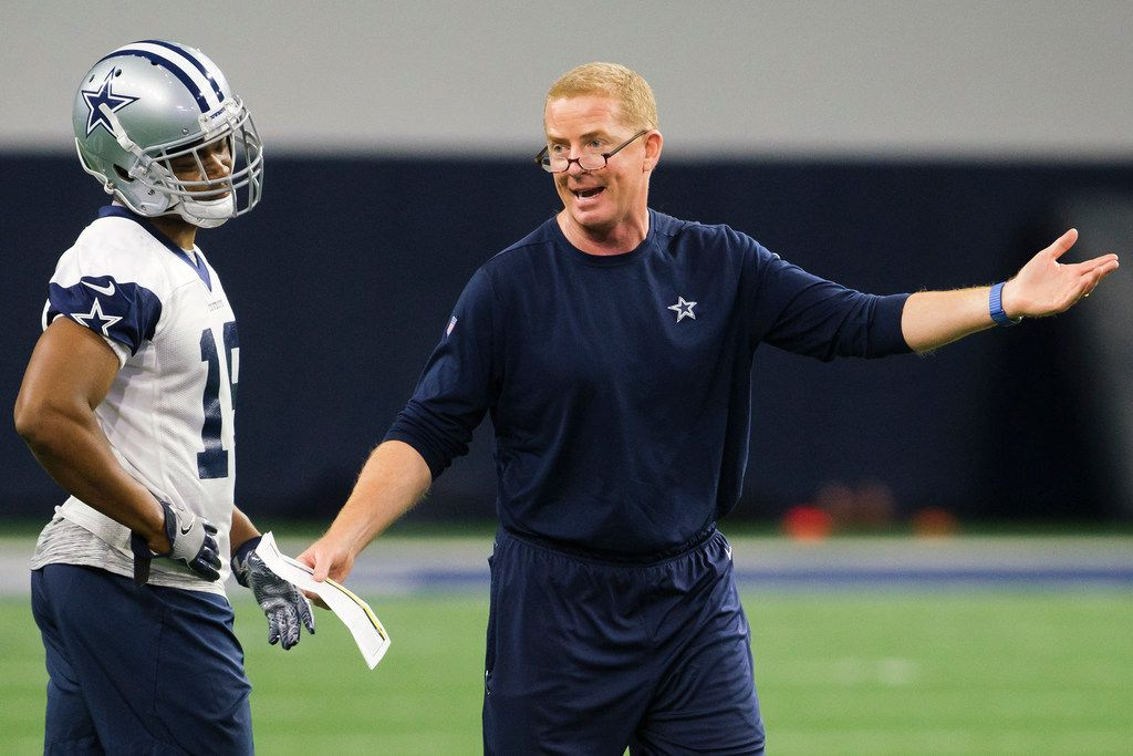 Dallas Cowboys head coach Jason Garrett makes a point as wide receiver Amari Cooper listens during a team OTA practice at The Star on Wednesday, June 5, 2019, in Frisco. (Smiley N. Pool/The Dallas Morning News)