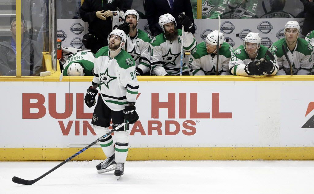 Dallas Stars center Tyler Seguin (91) watches the replay after Nashville Predators left wing Filip Forsberg scored the winning goal during the third period of an NHL hockey game Sunday, Feb. 12, 2017, in Nashville, Tenn. The Predators won 5-3. (AP Photo/Mark Humphrey)