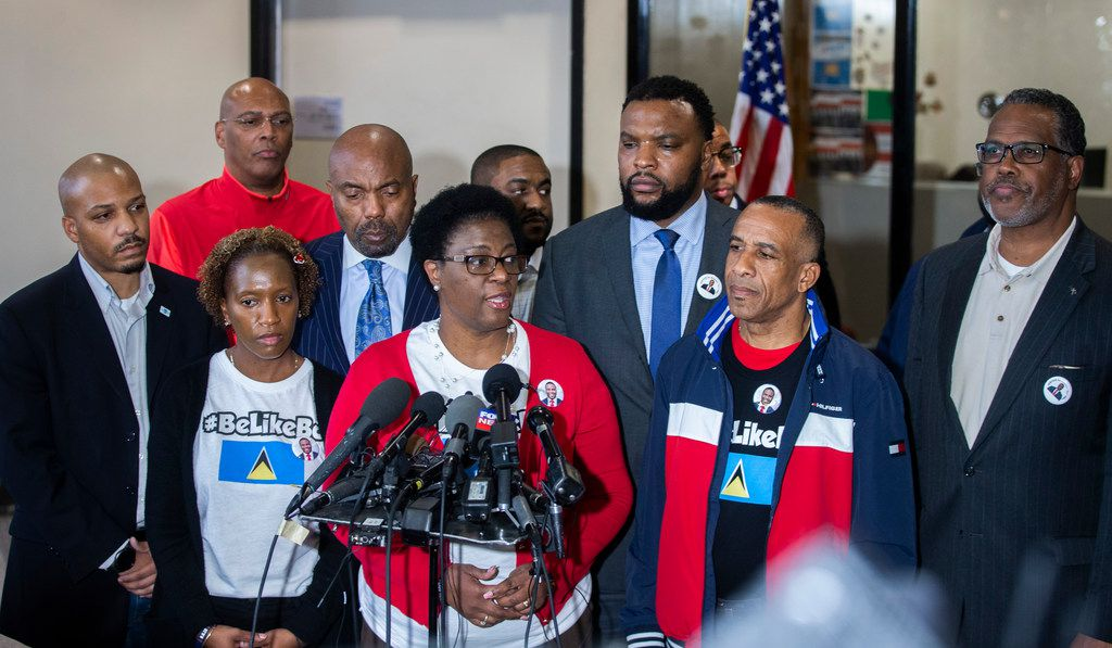 Allison Jean, Botham Shem Jean's mother, center, gives remarks during a press conference at the Frank Crowley Courts Building in Dallas on Friday, November 30, 2018. Botham Shem Jean was shot by former Dallas police officer, Amber Guyger, who was off duty, in his apartment on September 6, 2018.