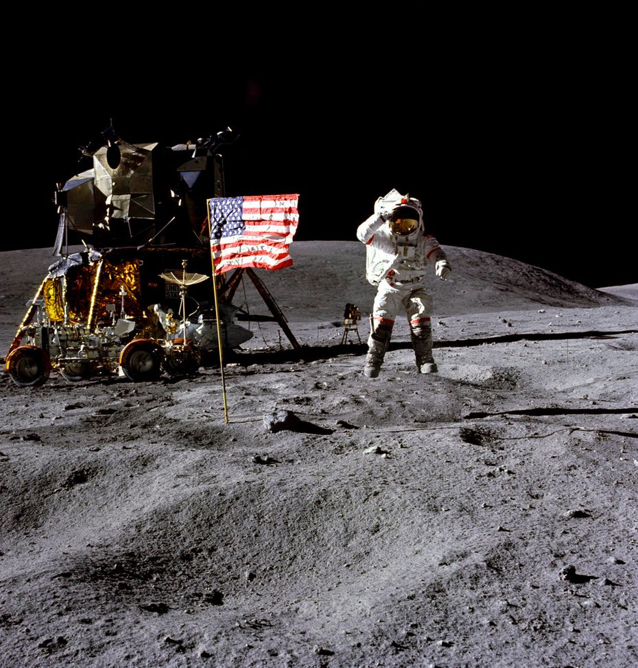 In this April 1972 photo made available by NASA, John Young salutes the U.S. flag at the Descartes landing site on the moon during the first Apollo 16 extravehicular activity. NASA says the astronaut, who walked on the moon and later commanded the first space shuttle flight, died on Friday, Jan. 5, 2018. He was 87.
