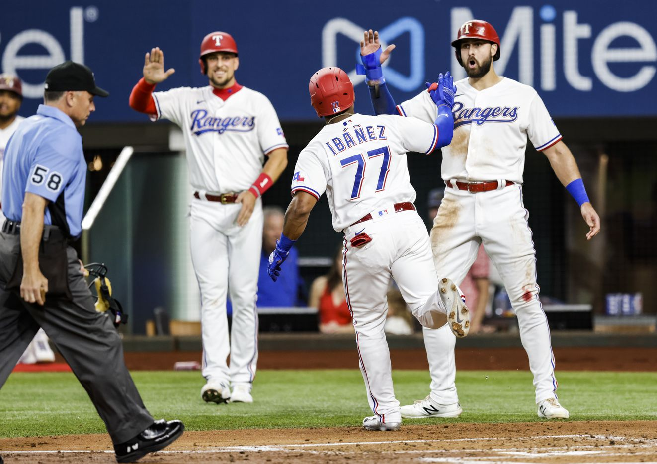 Texas Rangers' Andy Ibanez (77) is congratulated after hitting a three-run home run during the first inning of a baseball game against the Oakland Athletics in Arlington, Monday, June 21, 2021. (Brandon Wade/Special Contributor)