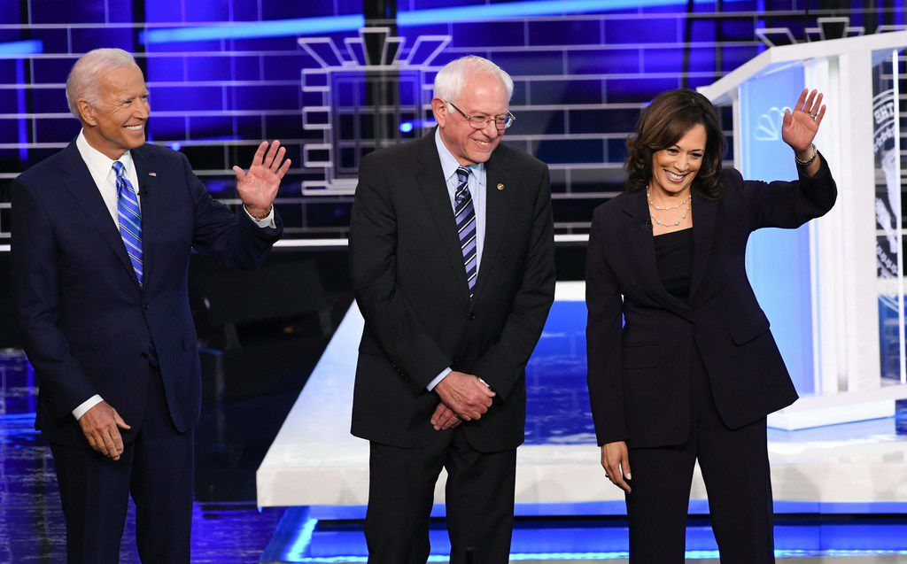 Democratic presidential hopefuls (from left) Joe Biden, Bernie Sanders and Kamala Harris arrive on stage for Part 2 of the first Democratic presidential debate.