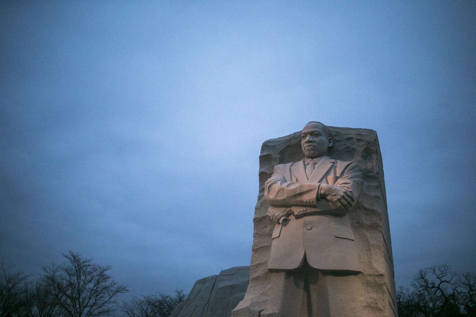 The Martin Luther King Jr. Memorial as the sun rises on a cloudy morning in Washington.