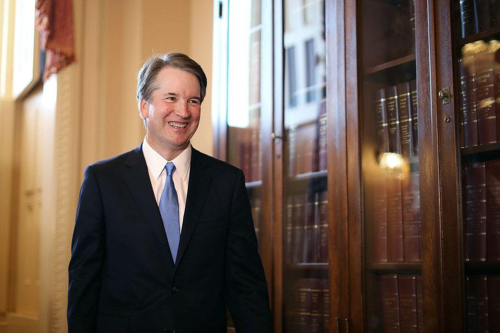 Judge Brett Kavanaugh leaves the room following a meeting and press availability with Senate Judiciary Committee Chairman Charles Grassley, R-Iowa, at the U.S. Capitol on July 10, 2018, in Washington, D.C. President Donald Trump nominated Kavanaugh to succeed retiring Supreme Court Associate Justice Anthony Kennedy.