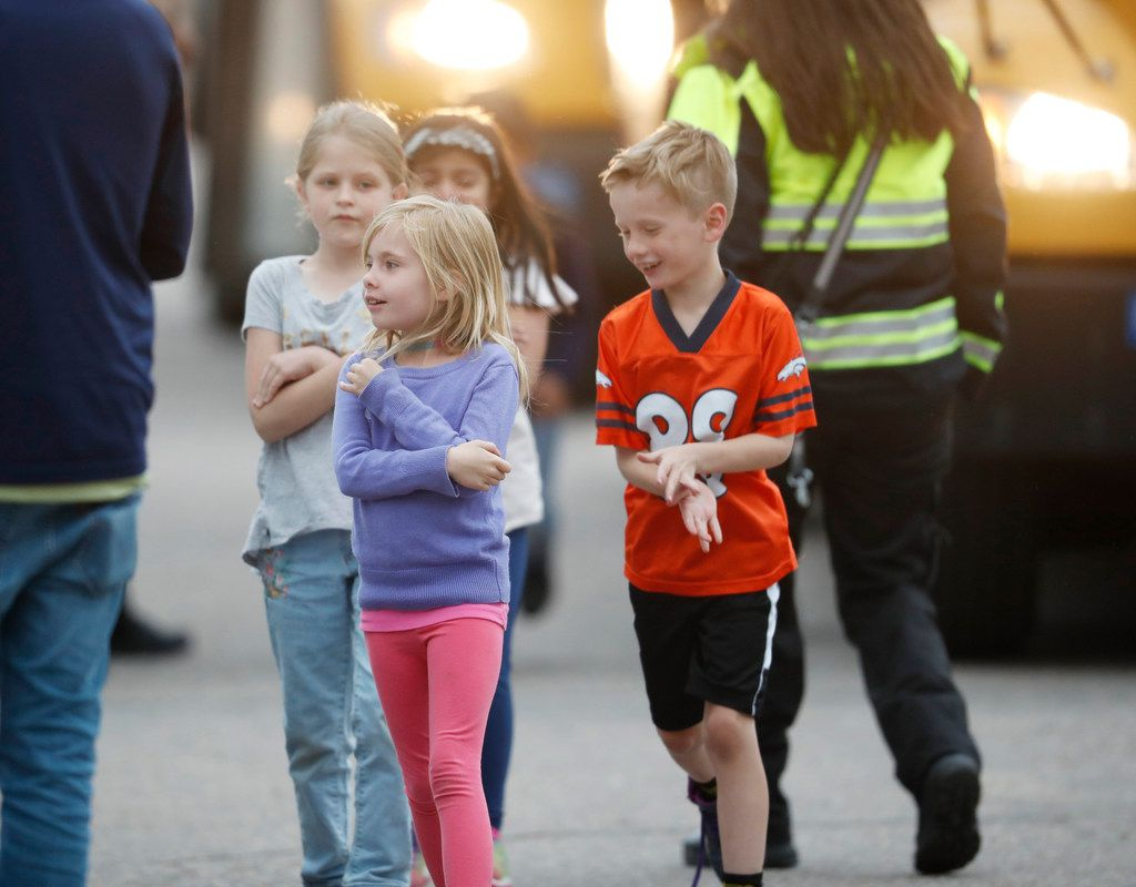 Students were led from a bus into a recreation center where they were reunited with their parents after a shooting at a suburban Denver middle school Tuesday, May 7, 2019, in Highlands Ranch, Colo.
