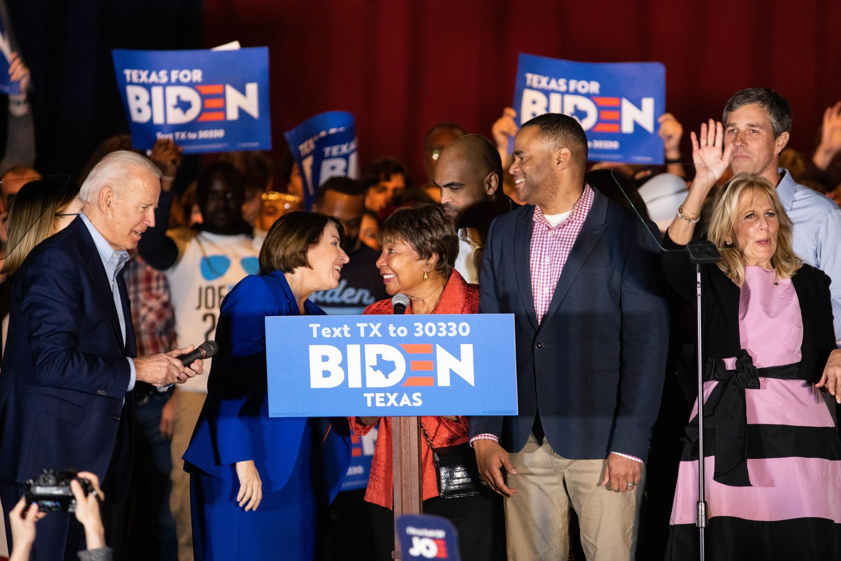 Democratic presidential primary candidate Joe Biden (far left) was endorsed by (from left) Sen. Amy Klobuchar (D-MN), Rep. Eddie Bernice Johnson (D-Dallas), Rep. Colin Allred (D-Dallas), Rep. Mark Veasey (D-Fort Worth) and former Rep. Beto O'Rourke of El Paso during a rally at Gilley's in Dallas on Tuesday. Biden's wife, Jill, is at far right.