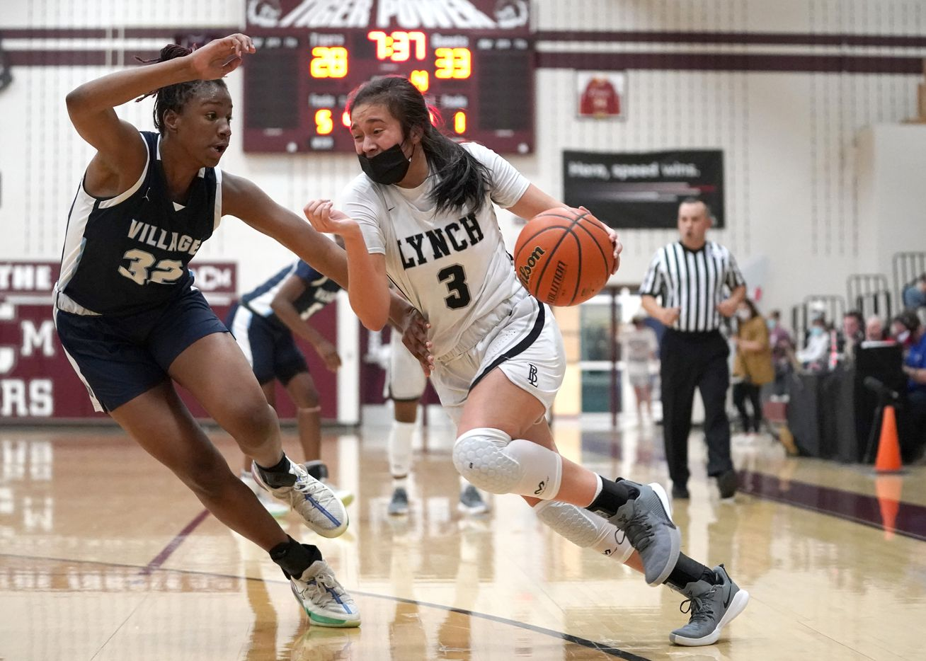 Dallas Bishop Lynch's Natalie Cardenas (3) drives the lane against The Village School's RyLee Grays (32) during the TAPPS 6A girls basketball championship game at A&M Consolidated High School in College Station, Texas on Friday, March 12, 2021. (Sam Craft/Special Contributor)