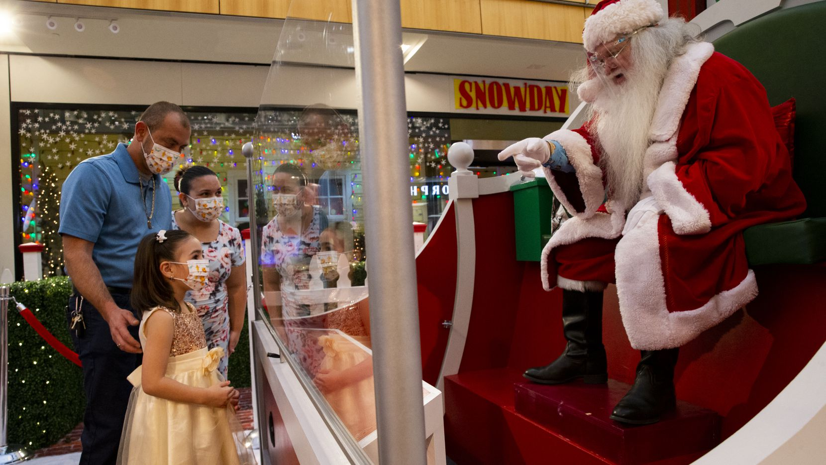 Aryana Martinez, 5, visits Santa Claus with dad Jaime Martinez and mom Shaila Martinez while at the Galleria in Dallas on Sunday, Martinez couldn't remember what she asked Santa for Christmas but said it was good to see him.