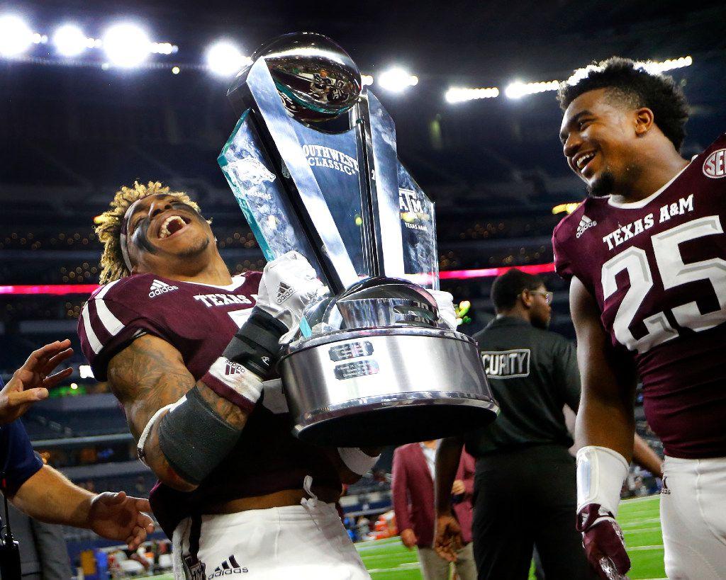 Texas A&M Aggies running back Trayveon Williams (5) hoists the winning Southwest Classic trophy after defeating Arkansas Razorbacks, 45-24, at AT&T Stadium in Arlington, Texas, Saturday, September 24, 2016. (Tom Fox/The Dallas Morning News)
