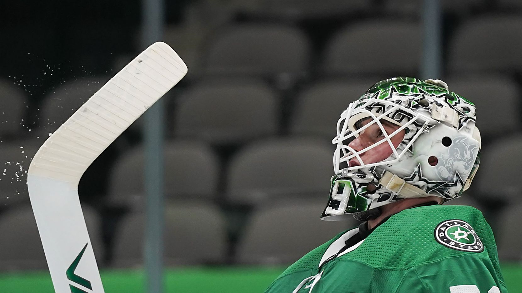 Dallas Stars goaltender Jake Oettinger reacts after giving up a Tampa Bay Lightning goal during the second period of an NHL hockey game at the American Airlines Center on Thursday, March 25, 2021, in Dallas. (Smiley N. Pool/The Dallas Morning News)