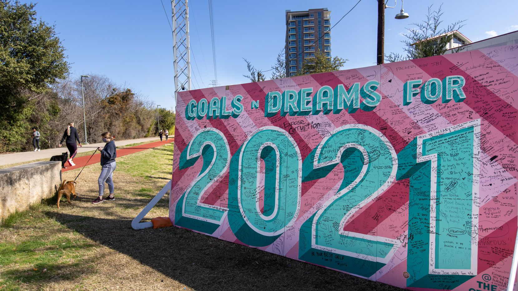 A mural designed by artist Brennen Bechtol offers space for passersby to share their thoughts for the new year along the Katy Trail near Routh Street.